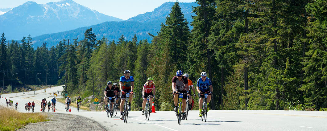 Cyclists ascend the Sea to Sky highway, traffic free