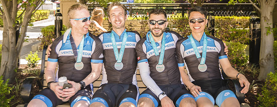 Corporate team enjoying the sun after the ride in Celebration Plaza