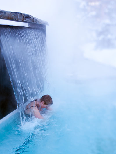 A woman enjoys outdoor spa treatment in Whistler