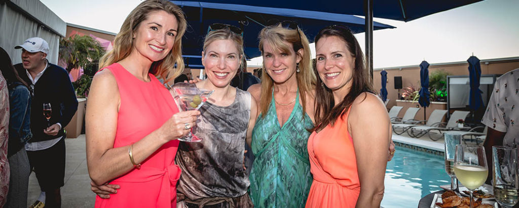 Guests enjoy the exclusive poolside party
