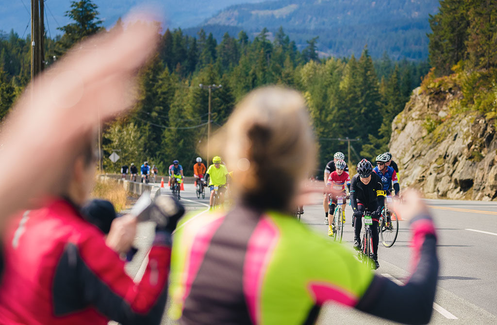 Crowds cheer on riders on the Sea to Sky course