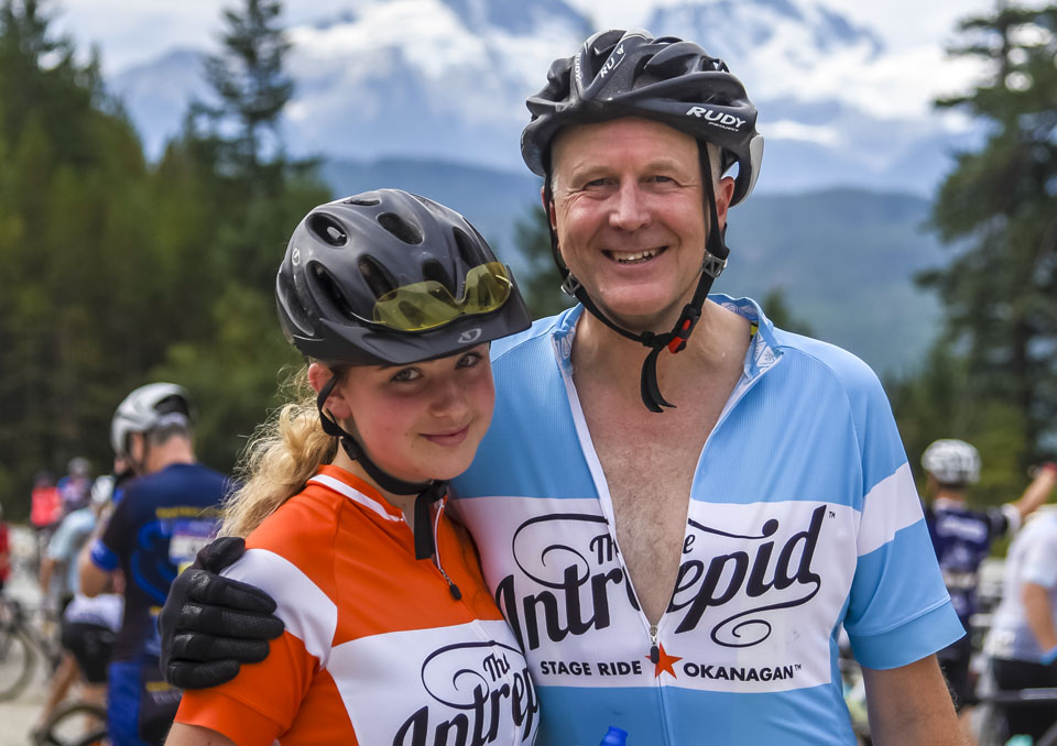 A father and daughter smile in the Gran Fondo sunshine in Whistler, BC